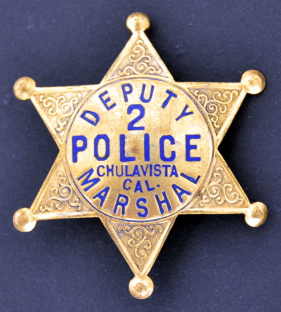 This badge made by Cal Stamp in San Diego dates back to the days when the police department was headed by the Marshal.