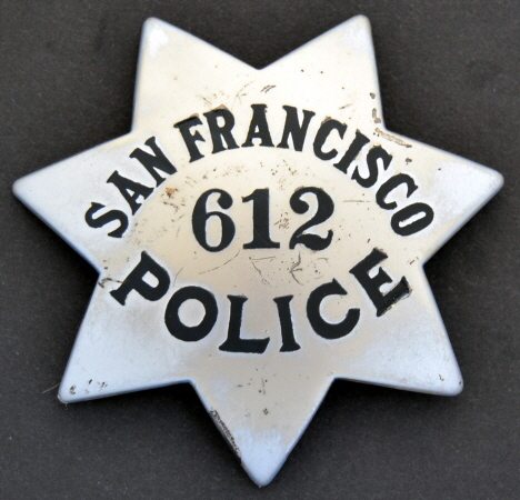 San Francisco Police Officer John Bacigalupi wearing badge #612, was appointed 8-8-21.  Made by Irvine & Jachens.  9-1-21.  Sterling.