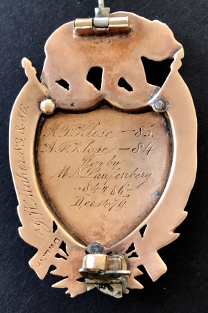 Made by San Francisco Jeweler D. W. Laird.  Names on back are of the winners and the years won.  All of the winners as well as the badge maker were members of the California Rifle Association and  members California National Guard.