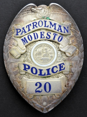 Modesto Police Patrolman badge #20, circa 1944.  Rivet back, hallmarked Los Angeles Stamp and Staty.