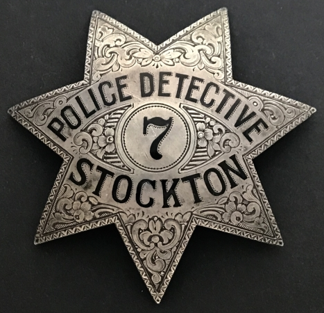 "A perfect example of the ""jewelers art"" this hand engraved Stockton police detective star #7 is made of sterling silver and hallmarked Ed Jones Co. Oakland.  Circa 1925."