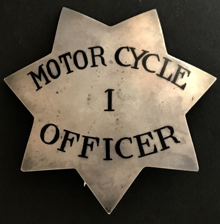 "This large #1 ""pie plate"" star was worn by Stockton Police Motor Cycle officer Elmer Haegney from June 14, 1914 to December 1, 1917 and W. R. Kennedy January 1, 1918 to June 15, 1919.  John Shoemaker was also assigned.  Badge is sterling silver."