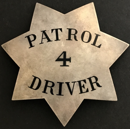 "This large #4 ""pie plate"" star was worn by Patrol Driver of the Stockton Police Department, 1915-1928 and is sterling silver."