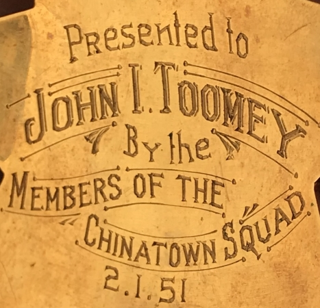 Presented to John I. Toomey By The Members Of The Chinatown Squad.  2-1-51.