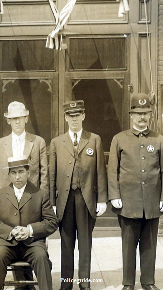 Standing center is Chief and on the right is Ira Cresap who later became Sheriff of Clarke County, WA