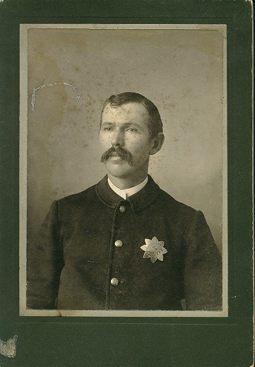 Image of a Pasadena policeman wearing 1st issue badge #3.